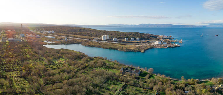 Panoramic aerial view of the construction of future LNG terminal on the shore of the bay, Omisalj, Croatia - AAEF08196