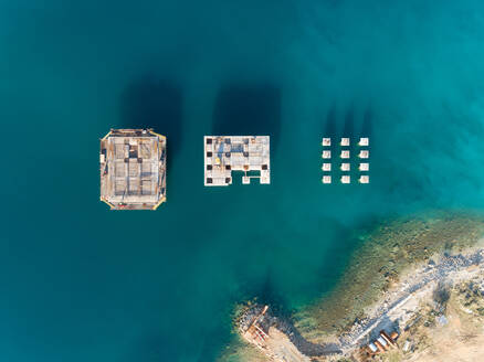 Aerial view of concrete platforms at the construction of future LNG terminal on the shore of the bay in Omisalj, Croatia - AAEF08205