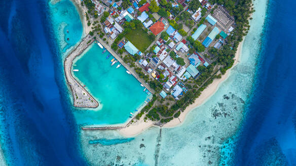 Aerial view of local, inhabited island Felidhoo, located in Vaavu Atoll, Maldives, Indian Ocean with boats / dhonis anchored in the harbour and local beach - AAEF08304