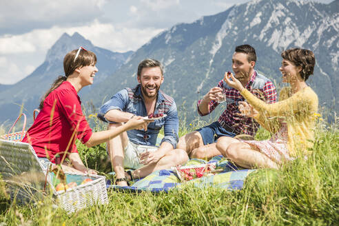Friends having a picnic on a meadow in the mountains, Achenkirch, Austria - SDAHF00814