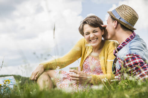 Happy couple having a picnic on a meadow in the mountains, Achenkirch, Austria - SDAHF00823