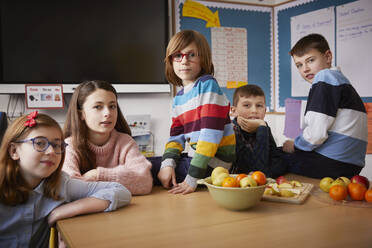Portrait of five children in a classroom during break time - PWF00074