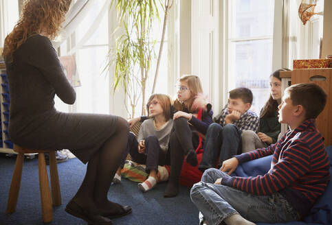 Children in a classroom during story time with the teacher - PWF00077