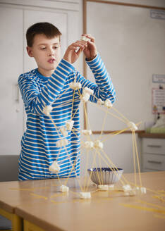 Boy setting up construction during a science lesson - PWF00101
