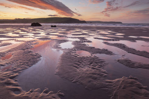Pink sunrise skies in winter above the sandy beach at Bigbury-on-Sea, South Hams, Devon, England, United Kingdom, Europe - RHPLF14701
