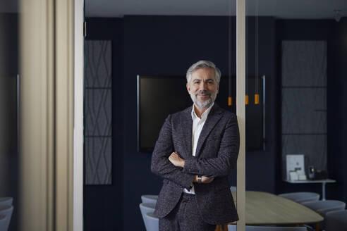 Portrait of confident mature businessman in office - RBF07636