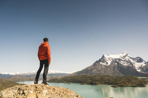 Hiker in mountainscape at Lago Pehoe in Torres del Paine National Park, Patagonia, Chile - UUF20244