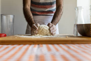 Crop view of man kneading dough - WPEF02883