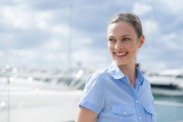 Portrait of happy woman at marina, Mallorca, Spain - DIGF10369