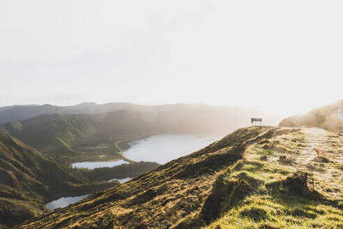 Scenic view of Lagoa do Fogo and mountains against clear sky during sunset, San Miguel, Azores, Portugal - FVSF00243