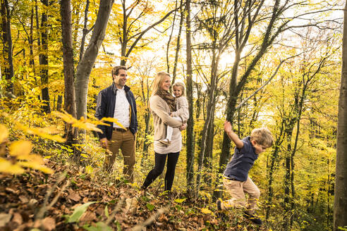 Family enjoying in forest during autumn - WFF00397