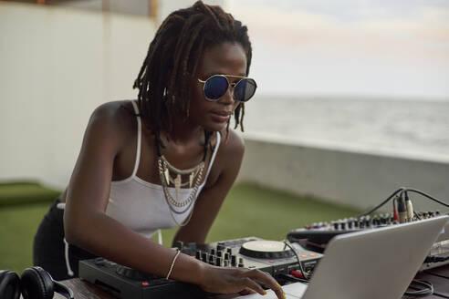 Portrait of DJane working on mixing board - VEGF02123
