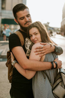 Happy young couple embracing in the city, Berlin, Germany - VBF00002
