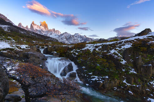 Mount Fitz Roy and waterfall at sunrise in Autumn, El Chalten, Patagonia, Argentina - LOMF01085