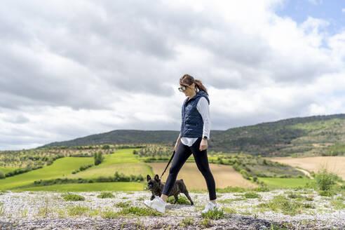 Woman going walkies with her bulldog, Castilla La Mancha, Spain - OCMF01209