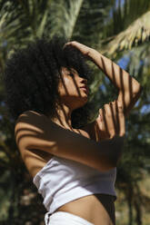 Portrait of young woman with shadow on her body - TCEF00625