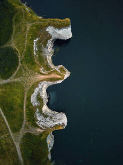 Aerial view of a curious letter-shaped formation along the cliff at Old Harry Rocks, Studland, Dorset, England. - AAEF08355