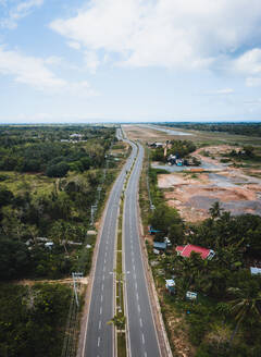 Aerial view of an empty highway due to the coronavirus pandemic in Panglao, Bohol, Philippines - AAEF08469
