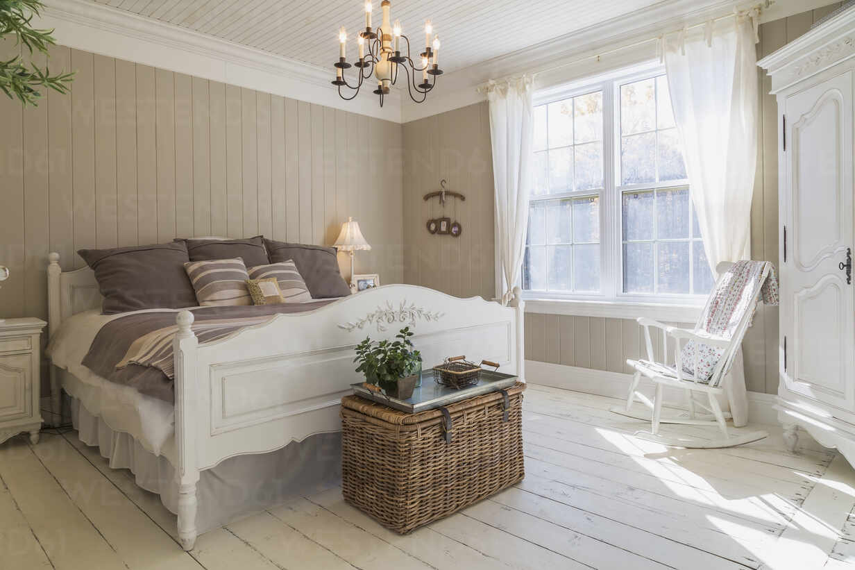 Bedroom With Double Bed Cream Painted Floorboards Brown Wood Panelled Wall White Furniture And Curtains Isf24095