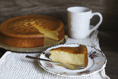 Marzipan cake slice on plate and coffee cup - VBF00052
