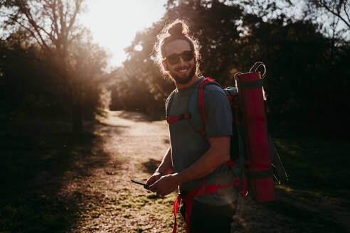 Bearded man with smartphone on a hiking trip - EBBF00021