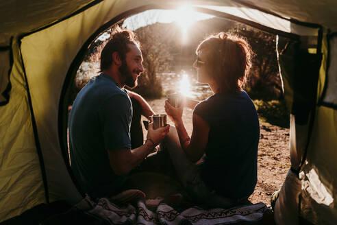 Happy couple camping at lakeside - EBBF00033