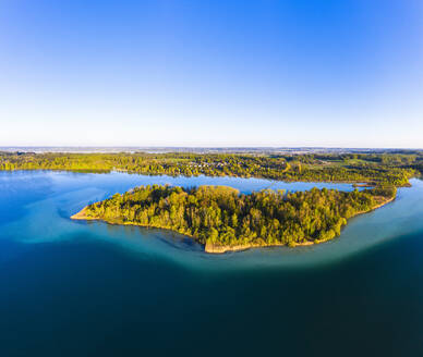 Germany, Bavaria, Inning am Ammersee, Drone view of clear sky over forested shore of Worth island - SIEF09839