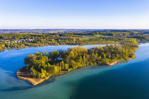 Germany, Bavaria, Inning am Ammersee, Drone view of clear sky over forested shore of Worth island  - SIEF09842