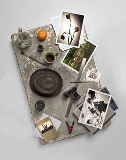 Work table with various photographs and photographic equipment - SKAF00146