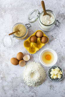 Butter, chicken eggs and jars of flour and brown sugar - GIOF08198