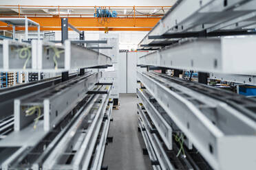 Metal bars on shelf in a factory - DIGF11239