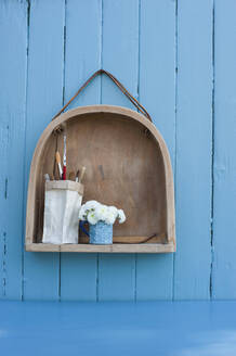 Shelf made from old wooden chair and brush holder made from milk carton - GISF00588