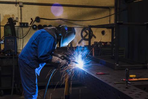 Welder welding metal in a factory - DIGF11358