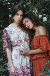 Two beautiful women embracing in nature - TCEF00697