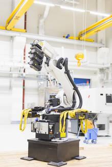 Industrial robot on factory shop floor - DIGF11475