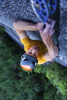 Man placing big cam in granite off-width crack lead climbing Squamish - CAVF82321