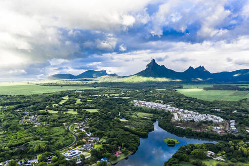 Mauritius, Black River, Flic-en-Flac, Helicopter view of oceanside village in summer with Trois Mamelles range in background - AMF08122