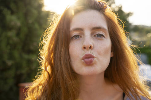 Portrait of redheaded woman with kissing lips - AFVF06363