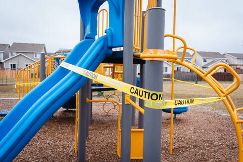 Playground equipment wrapped in caution tape during Covid 19 pandemic. - CAVF83061