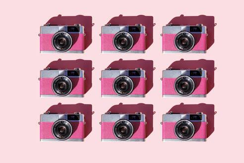 Pattern of rows of vintage analog cameras - GEMF03774