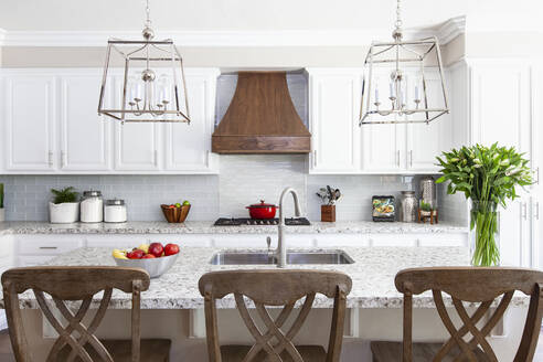 White modern farmhouse kitchen with red and green accents - CAVF83339