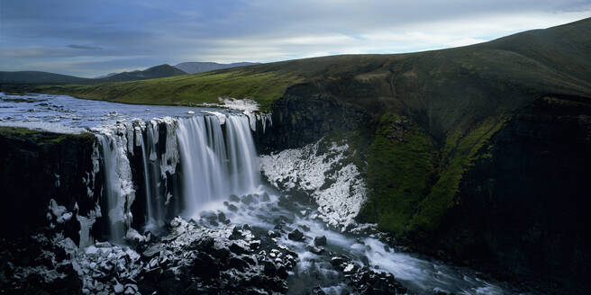 Unnamed half frozen waterfall in the Icelandic highlands - CAVF83390