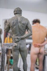 Sculpture and naked model in the background - FBAF01569