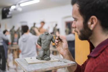 Student forming sculpture - FBAF01572