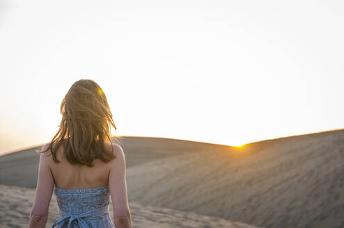 Woman at sunset in the dunes, Gran Canaria, Spain - DIGF12551