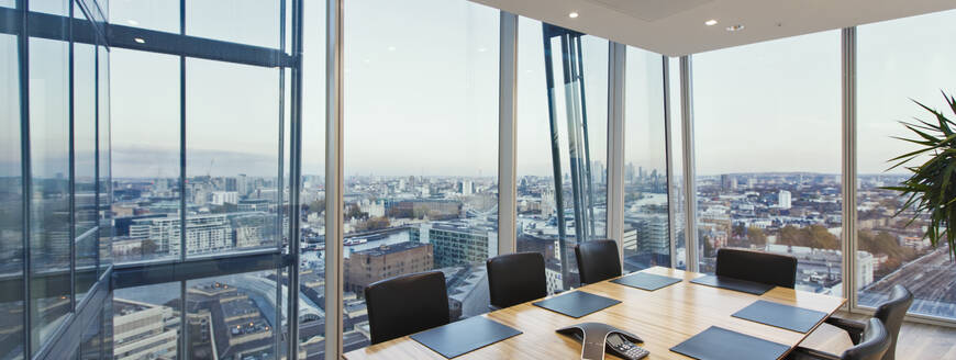 Modern conference room overlooking cityscape, London, UK - CAIF27783