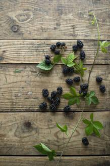 Fresh blackberries on wooden surface - ASF06623