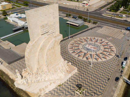 Aerial view of Monument to the Discoveries, on a partial sunny day, durind the pandemic Covid-19, in Lisbon, Portugal's capital. - AAEF08713