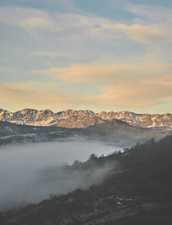 Scenic view of rocky mountains against sky during sunrise, Leon, Spain - FVSF00418