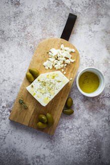 Cutting board with feta cheese and olives - GIOF08357
